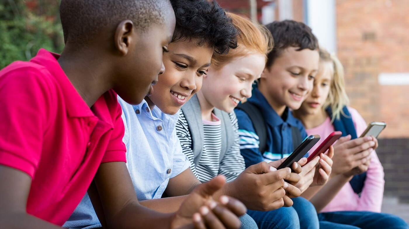 Children playing with phones