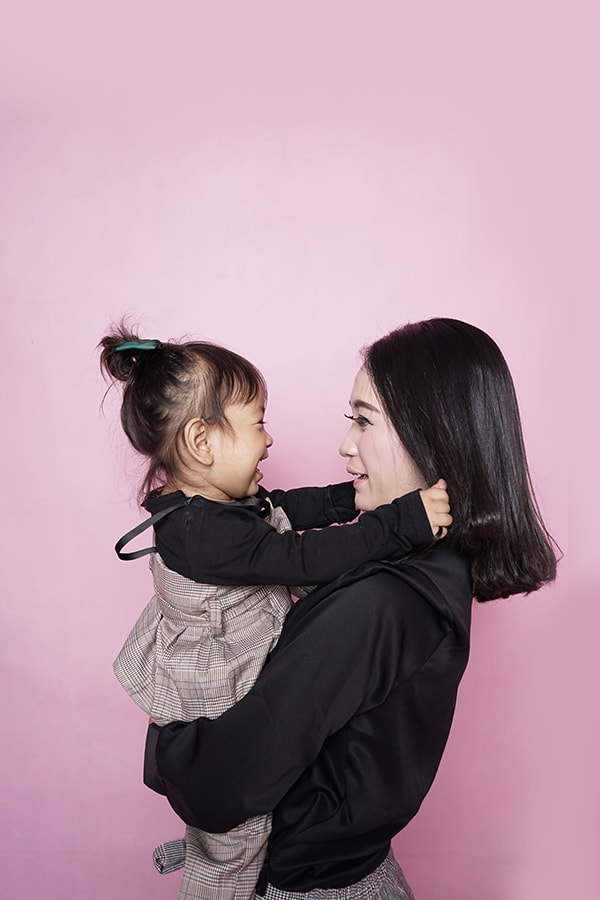 Woman holding her daughter