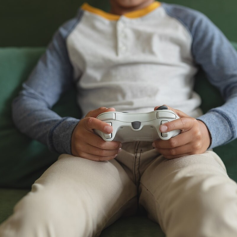 Kid playing xbox