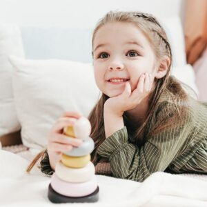 Girl playing with toy